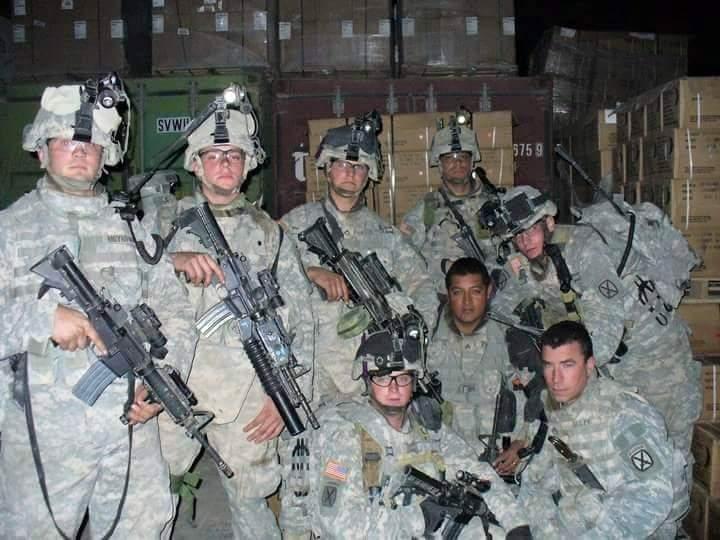 John Moynihan can be seen far left in this photograph taken in Iraq.